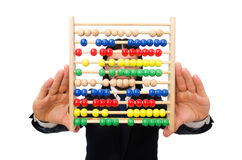 Funny man with calculator and abacus Royalty Free Stock Photo