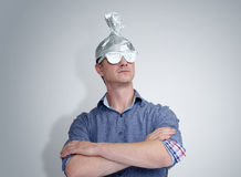 Funny man in a cap of aluminum foil. Concept art phobias Stock Photography