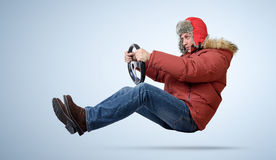 Funny man in cap driving a car in winter Stock Images
