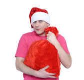 Funny man in cap Santa Claus with red bag of gifts on white background. File contains a path to isolation Royalty Free Stock Photos