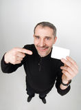 Funny man with card Royalty Free Stock Photo