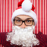 Funny man for christmas. Man with beard and cover of santa claus Royalty Free Stock Photos