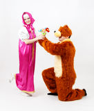 Funny man in costume of bear and girl from fairy tale posing Stock Photography
