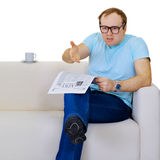 Funny man dissatisfied with news from newspaper Royalty Free Stock Photo
