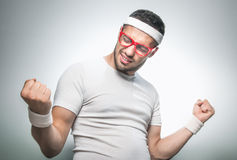Funny man doing aerobics Royalty Free Stock Image