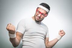 Funny man doing aerobics royalty free stock image