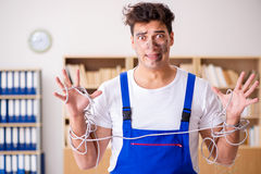 The funny man doing electrical repairs at home Stock Images