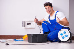 The funny man doing electrical repairs at home. Funny Man doing electrical repairs at home Royalty Free Stock Photo