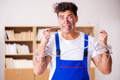 The funny man doing electrical repairs at home Stock Photography