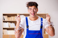 The funny man doing electrical repairs at home Royalty Free Stock Photography