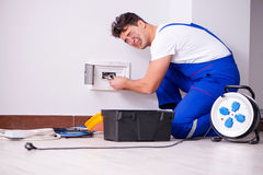 The funny man doing electrical repairs at home. Funny Man doing electrical repairs at home Stock Photos
