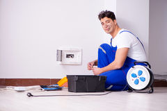 The funny man doing electrical repairs at home Stock Photos