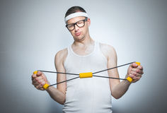 Funny man doing gym royalty free stock images
