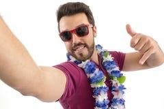 Selfie. POV. Man enjoys the Carnival. Party. Beautiful and beard stock photos