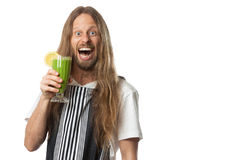 Funny man drinking green vegetable smoothie. Funny portrait of a very happy hippie man drinking a green vegetable smoothie. Isolated on white Stock Photo
