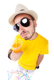 Funny man drinking juice wearing sun glasses, hat and yellow t shirt Royalty Free Stock Photography