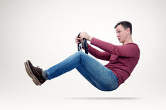 Funny man drives a car with a steering wheel Stock Image