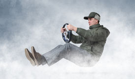 Funny man driving a car in winter. Winter driving concept Stock Images