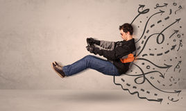 Funny man driving a flying vehicle with hand drawn lines after h Royalty Free Stock Photography