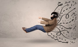 Funny man driving a flying vehicle with hand drawn lines after h Royalty Free Stock Image