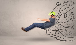 Funny man driving a flying vehicle with hand drawn lines after h Stock Photo