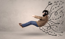 Funny man driving a flying vehicle with hand drawn lines after h Stock Image