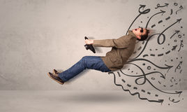 Funny man driving a flying vehicle with hand drawn lines after h Stock Photography