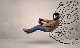Funny man driving a flying vehicle with hand drawn lines after h Stock Photos