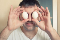 Funny man with eggs Stock Photos