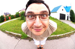 Funny man face in fisheye view. Standing on road in town Royalty Free Stock Photo