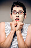 Funny man with facial mask and glasses Stock Images