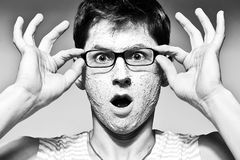 Funny man with facial mask and glasses Royalty Free Stock Photography