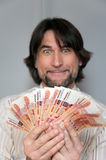 Funny man with a fan of Russian money Royalty Free Stock Images