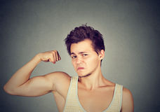 Funny man flexing biceps Royalty Free Stock Photography