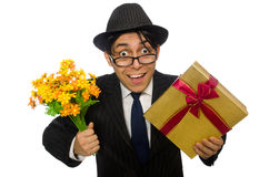 The funny man with flowers and giftbox Royalty Free Stock Images