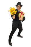 The funny man with flowers and giftbox Stock Images