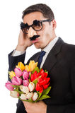 The funny man with flowers isolated on white Royalty Free Stock Photos
