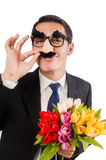 The funny man with flowers isolated on white Stock Image