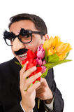 The funny man with flowers isolated on white Royalty Free Stock Photography