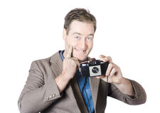 Funny man gesturing big smile with vintage camera Stock Images
