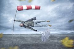 Free Funny Man Gets Blown Away By A Storm Stock Photo - 172776550