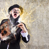 Funny man getting electric shock from old phone. Comic portrait of a shocked business man getting zapped by electrical current charge from vintage telephone Royalty Free Stock Photography