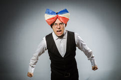 Funny man with giant bow tie Royalty Free Stock Photo