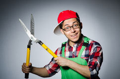 Funny man. With giant shears Stock Image