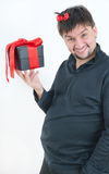 Funny man with gift in hand Stock Photography
