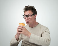 Funny man in glasses drink through a straw Stock Photos