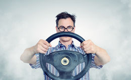 Funny man in glasses with a steering wheel Stock Photography