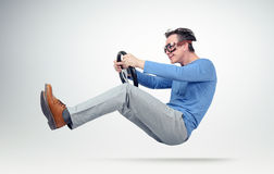 Funny man in goggles drives a car with a steering wheel Royalty Free Stock Photos