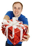 Funny man happily gives us a gift Royalty Free Stock Photography