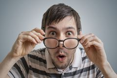Funny man has open mouth and is surprised and shocked Stock Photography
